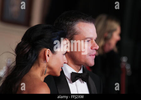 London, UK. 14th February, 2016. Matt Damon and partner attends the EE British Academy of Film and Television Arts - Stock Photo