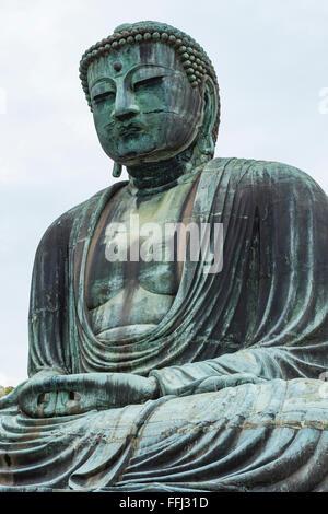 The Great Buddha (Daibutsu) on the grounds of Kotokuin Temple in Kamakura, Japan. - Stock Photo