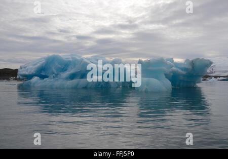 JOKULSARLON, ICELAND - JUN 18:  Icebergs reflect on Jokulsarlon, Iceland on June 18, 2015. The icebergs calved from - Stock Photo