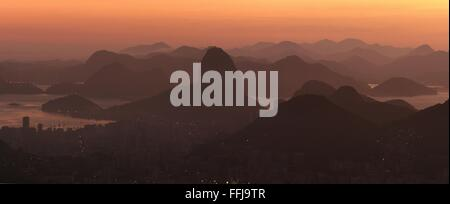 Rio de Janeiro, Brazil, 14th February. Rio de Janeiro at sunrise, seen from Vista Chinesa (Chinese Belvedere) in - Stock Photo