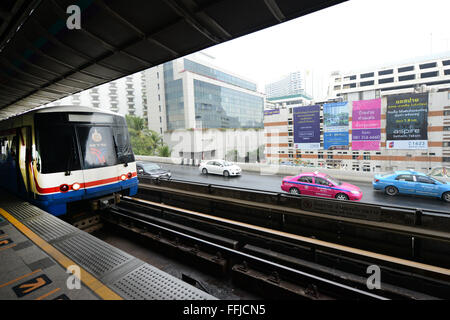 Skytrain at the Saphan Taksin BTS station in Bangkok. - Stock Photo