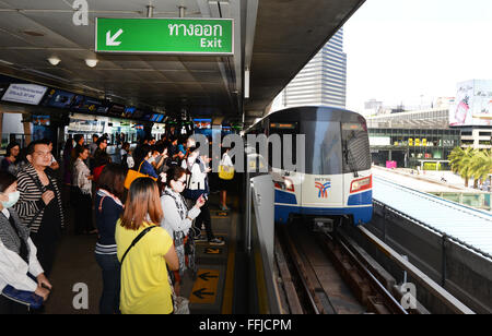 Passengers waiting for the BTS skytrain at Siam sq. station in Bangkok. - Stock Photo