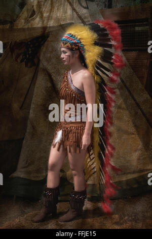 Thai girl in traditional Native American Indian costume at the Burapha biker festival Pattaya Thailand S. E. Asia - Stock Photo