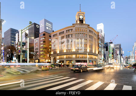 Tokyo, Japan - January 18, 2015:  Ginza shopping district at rush hour in Tokyo, with the iconic Ginza Wako building. - Stock Photo
