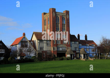 Eccentric mock Tudor architecture of water tower and houses, Thorpeness, Suffolk, England - Stock Photo
