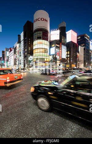 Tokyo, Japan - January 18, 2015:  Ginza shopping district at rush hour in Tokyo with iconic  Sanaa Building . - Stock Photo