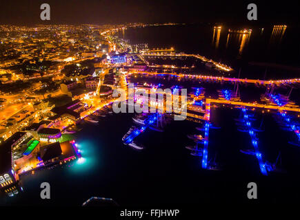 Aerial night view of the beautiful Marina in Limassol city in Cyprus. A very modern, high end and newly developed - Stock Photo