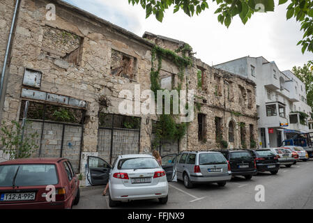 Abandoned building, detroyed during Bosnian War in Mostar city, Bosnia and Herzegovina - Stock Photo