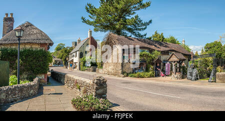 Traditional thatched cottages at the village Godshill on the Isle of Wight, South East England. - Stock Photo