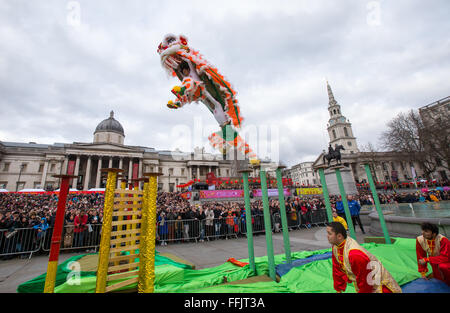 Chinese New Year celebrations in Trafalgar Square,Thousands watch the spectacular Dragon Dance performance - Stock Photo