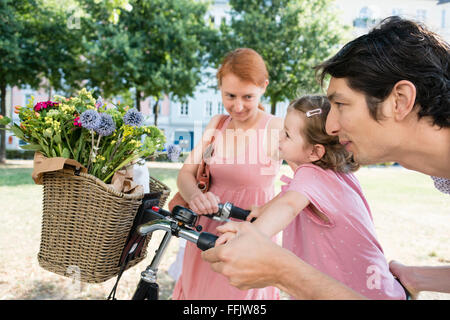 Family with two children and bicycle - Stock Photo
