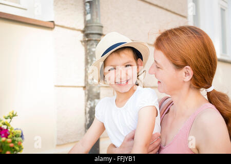 Portrait of mother with daughter in city - Stock Photo