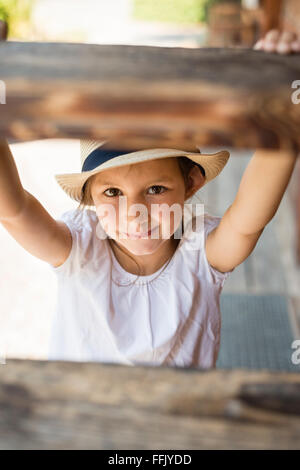Portrait of little girl with sun hat - Stock Photo