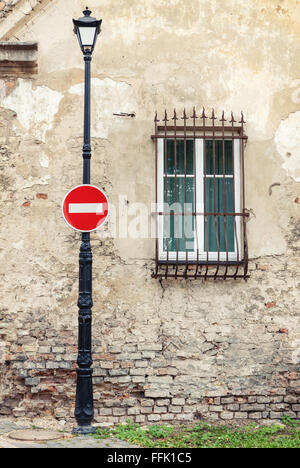 No entry road sign on street lamp post - Stock Photo