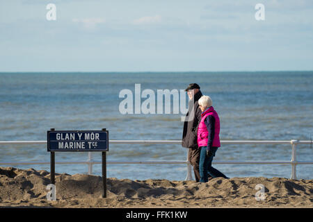 Aberystwyth, Wales, UK. 15th February 2016.  UK weather: A couple out enjoying a day of  warm winter sunshine walking - Stock Photo