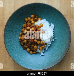 Red chickpea curry with white rice - Stock Photo