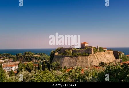 Ulcinj ancient fortress and old town at sunset - Stock Photo