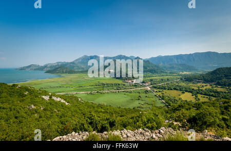 Montenegro landscape with Virpazar town, Skadar lake national park and the mountains range - Stock Photo