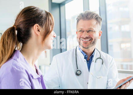 Doctor and nurse with digital tablet in hospital - Stock Photo