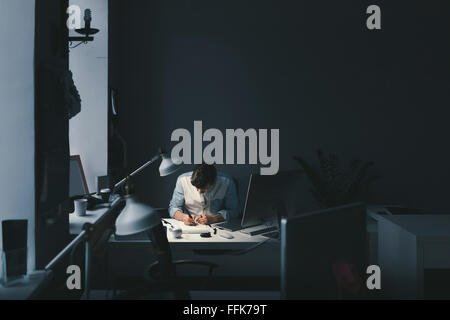 Designer at work in office - Stock Photo
