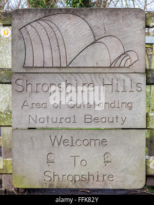 Shropshire Hills Area of Outstanding Natural beauty sign on Offa's Dyke on the English/Welsh border near Knighton, - Stock Photo