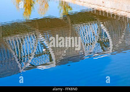 Perrault bridge reflecting on river Manzanares. Madrid Rio, Madrid, Spain. - Stock Photo