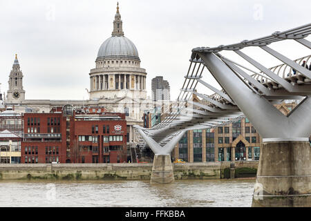 St Paul's Cathedral and the Millennium Bridge over the River Thames in London - Stock Photo