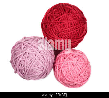Isolated three skeins in pink over white background macro - Stock Photo