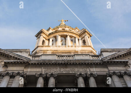 The statue of Lady Justice or the Scales of Justice above the Central Criminal Court, Old Bailey, with a jet passing - Stock Photo