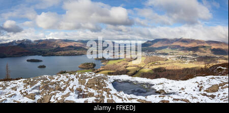 Keswick, Derwent Water, Skiddaw, Catbells viewed from the snow dusted summit of Walla Crag on a cold, crisp, clear - Stock Photo