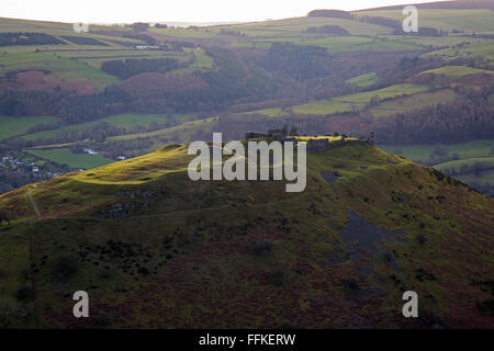 Looking west across Castell Dinas Bran, with the town of Llangollen below, in Wales. View from panoramic walk above - Stock Photo
