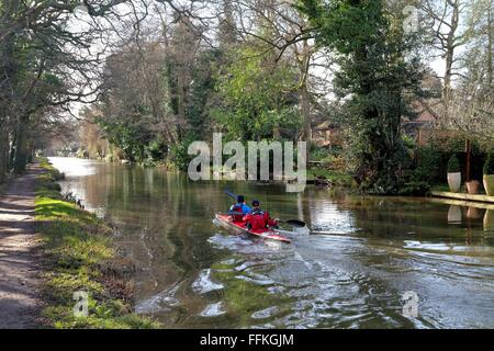 Two men canoing on the River Wey navigation Byfleet Surrey UK - Stock Photo