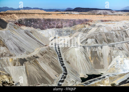 view of Mission open pit copper mine near Tucson from tour overlook with water collected at the deepest level, 1/4 - Stock Photo