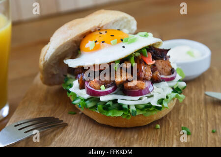 Japanese chicken burger with onions, letucce and egg - Stock Photo