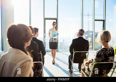Businesswoman giving presentation in business meeting - Stock Photo