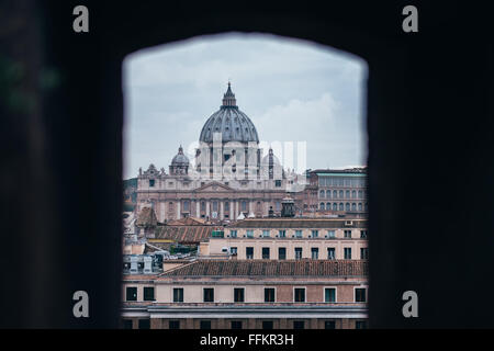 View of the Vatican and Saint Peter's Basilica as seen from a window in Castel Sant'Angelo in Rome - Stock Photo