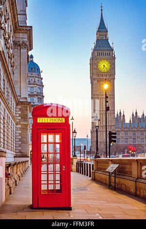 Traditional red phone booth in London - Stock Photo