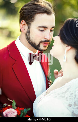 The bride and groom closeup, before kiss, outdoor, tenderness, passion. Wedding style Marsala, vertical portrait. - Stock Photo