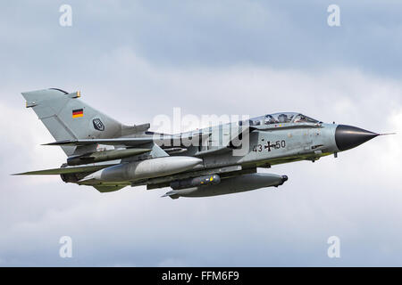 German Air Force (Luftwaffe) Panavia Tornado IDS 43+50 fighter aircraft departing Payerne Air Base in Switzerland. - Stock Photo