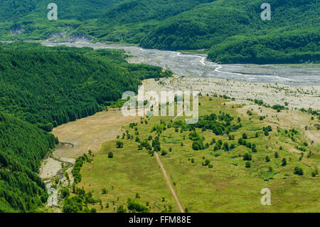 Water flows slowly through large areas of volcanic ash deposited by the 1980 eruption of Mount St Helens.  Toutle, - Stock Photo