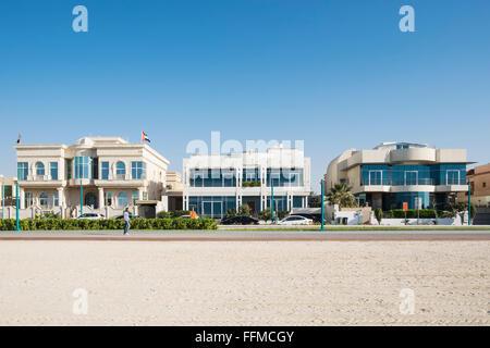 Luxury villas facing onto beach in Dubai United Arab Emirates - Stock Photo