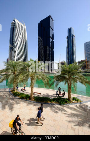 Daytime skyline view of modern high-rise office and apartment buildings at JLT, Jumeirah Lakes Towers Dubai United - Stock Photo