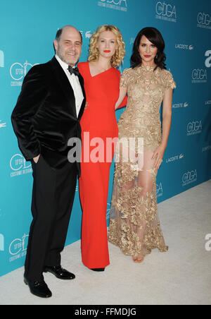 (L-R) Writer/producer Matthew Weiner, actress January Jones and costume designer Janie Bryant attend the 17th Costume - Stock Photo