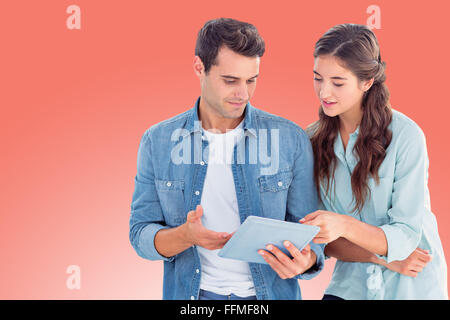 Composite image of business people with tablet - Stock Photo