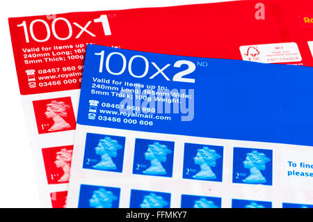 Sheets of 100 UK 1st and 2nd class stamps. - Stock Photo