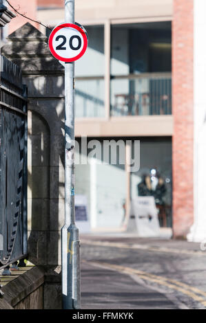 Twenty mile per hour speed limit sign reminder on a lampost in a city centre street. - Stock Photo