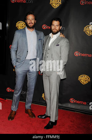 LAS VEGAS, CA - APRIL 21: Actors Armie Hammer (L) and Henry Cavill arrive at Warner Bros. Pictures Invites You to - Stock Photo