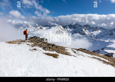 Female walker hiker in Pyrenees mountains in clouds - Stock Photo
