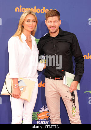 Soccer player Steven Gerrard (R) and wife Alex Gerrard arrive at the Nickelodeon Kids' Choice Sports Awards 2015 - Stock Photo
