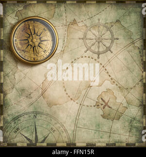 aged brass antique nautical compass and old treasure map - Stock Photo
